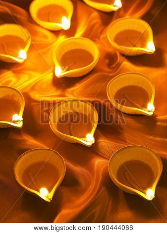 close up on burning oil lamp for deepavali
