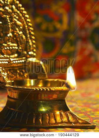 traditional indian oil lamp burning during deepavali