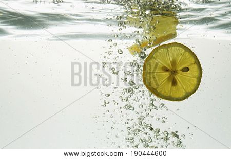 slices of lemon in water