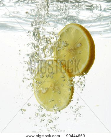 slices of lemon faling into water