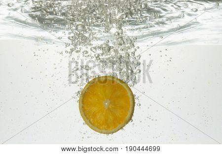 slice of orange in water