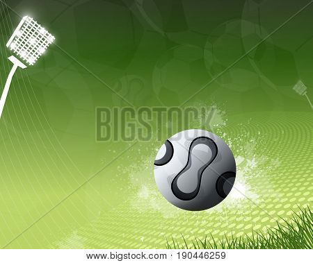 Football flying on green background with floodlight