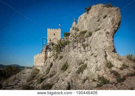 Closeup wide angle view of the castle of Sax, a fortress of century XV over big rock in the province of Alicante, spain