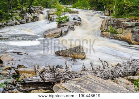 Lower Rosseau Falls are located in the District of Parry Sound in the Province of Ontario Canada.