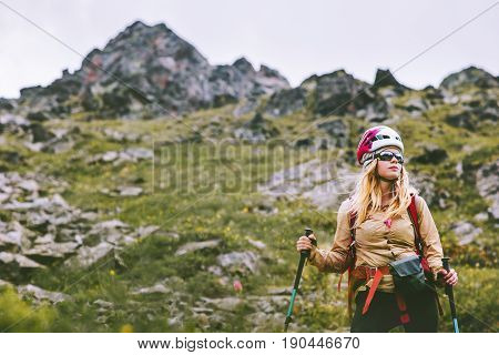 Woman climber hiking at rocky mountains Travel Lifestyle wanderlust concept summer vacations outdoor. Girl hiker with backpack and helmet climbing