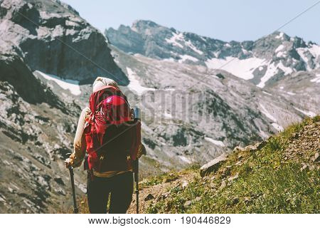 Hiker woman traveling at rocky mountains with backpack Travel Lifestyle wanderlust concept summer vacations outdoor active healthy life