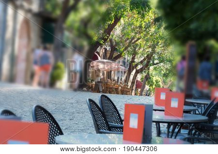 Narrow historic street with restaurant and cafes in the village of Valldemossa on Mallorca Spain