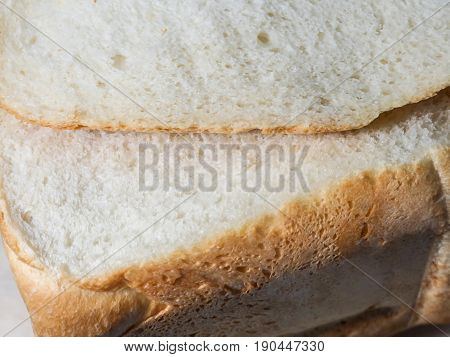 Cut fresh bread. White bread crumb. Homemade bread