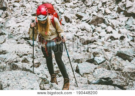 Hiker with backpack in mountains Travel Lifestyle adventure concept active vacations outdoor hiking mountaineering trail running sport stones on background