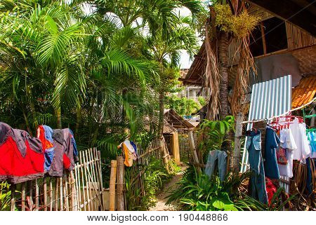 Rural House With Many Dried Clothes In Apo Island, Philippines