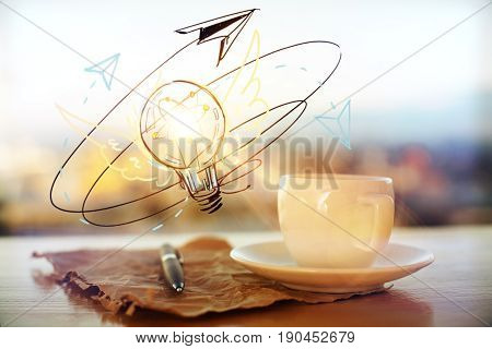 Close up of coffee cup crumples paper sheet with pen and lamp sketch on blurry city background. Idea concept