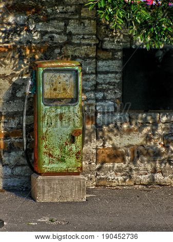 Old rusty gas station on a brick wall background. HDR toned