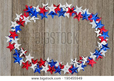 Patriotic USA red white and blue stars on weather wood background with copy space for your message