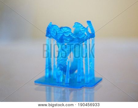 Objects photopolymer printed on a 3d printer. Blue ring. Stereolithography 3D printer, technology of liquid photopolymerization under UV light