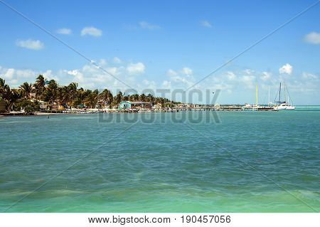 Beautiful tropical shoreline with piers for boats on the sleepy island of Caye Caulker on the Barrier Reef in the Caribbean Sea
