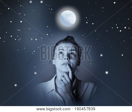 Young slim woman looking at full moon. Girl full of doubts and hesitation.