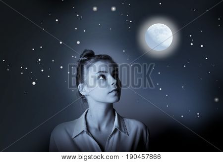 Young slim woman is looking at full moon. Girl full of doubts and hesitation.