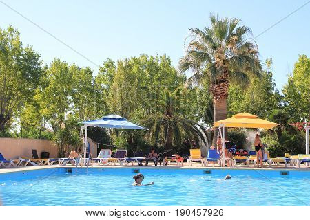 St Aygulf, Provence, France - August 24 2016: Holidaymakers Enjoying A Beautiful Pool In A French Me