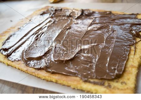 preparing a sponge cake with melted chocolate