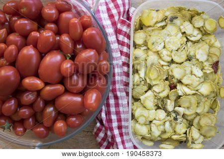 top view of zucchini in oil and fresh cherry tomatoes