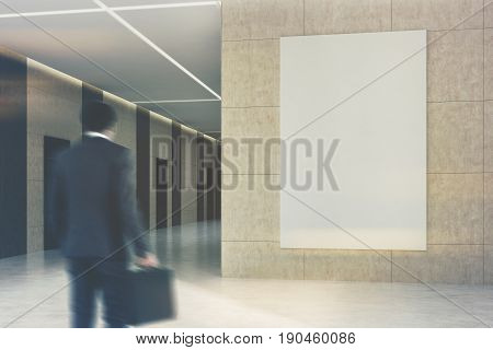 African American businessman in an office or a hotel lobby interior with dark brown wooden doors and beige walls with a vertical poster hanging on one of them. 3d rendering mock up