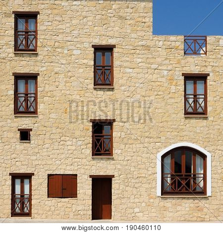 Stone wall house with few wooden windows