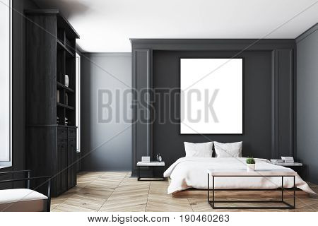 Luxury bedroom interior with gray and black walls a bookcase a double bed two bedside tables and wooden floor. Vertical poster. 3d rendering mock up