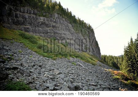The cliff face of Table Rock in Oregon and the rock slide below it