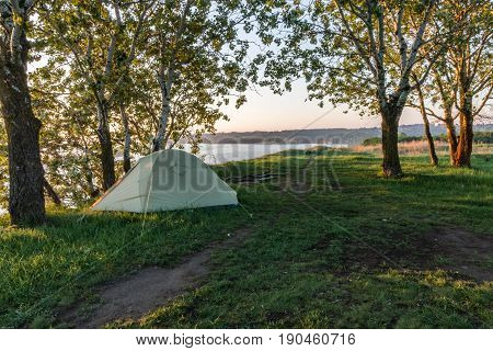 Early Morning In A Tourist Tent. A Tourist Tent On The River Bank Between The Trees.