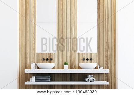 Wooden bathroom with a light wall two white sinks and two tall rectangular mirrors hanging above them. 3d rendering