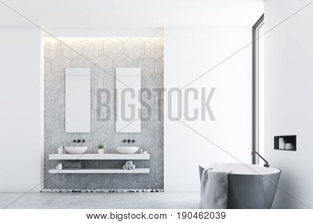Side view of a gray modern bathroom interior with a gray tub standing near a window a large towel hanging on its side and two sinks with mirrors. 3d rendering mock up