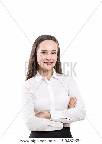 Isolated portrait of a cheerful young businesswoman standing with crossed arms and looking at you. She is wearing a white blouse and a black skirt.