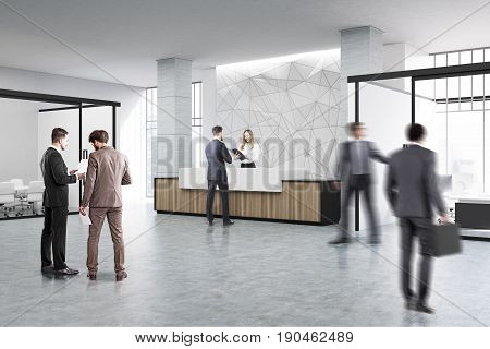 People near a wooden and white reception counter of original construction standing in an office lobby with a glass wall meeting room. 3d rendering