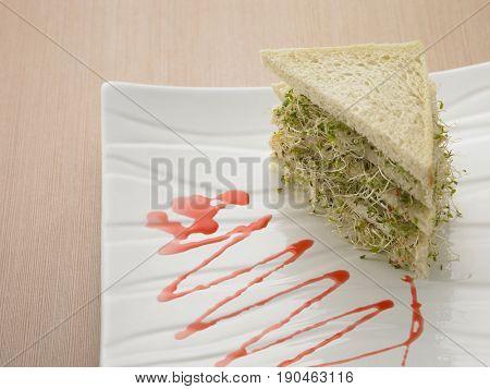 alfalfa sandwich on plate with strawberry jam