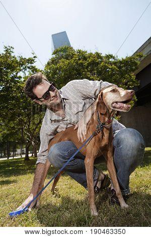 Man walking dog in urban park