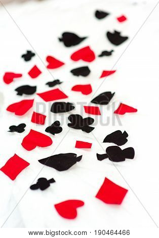 Signs of playing cards on a white neutral background.