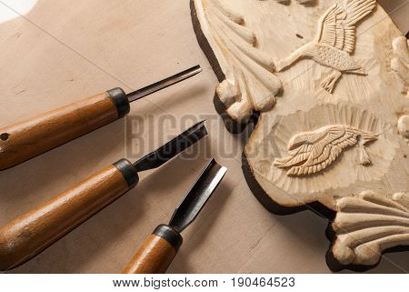 Tools for wood carving. Board with patterns.