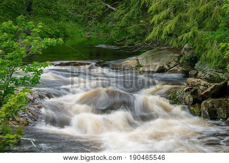 Small waterfall upstream from Lower Rosseau Falls Ontario Canada.