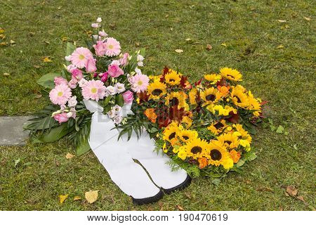 Beautiful floral arrangements on a funeral on meadow