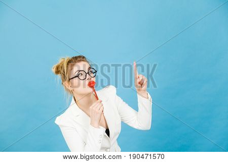 Woman Holds Fake Lips On Stick Pointing At Copy Space