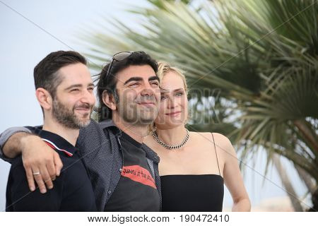 Fatih Akin, Diane Kruger attend the 'In The Fade (Aus Dem Nichts)' photocall during the 70th annual Cannes Film Festival at Palais des Festivals on May 26, 2017 in Cannes, France.