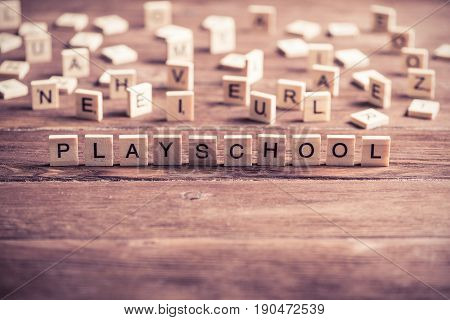 Alphabet letters on wooden pieces collected word playschool