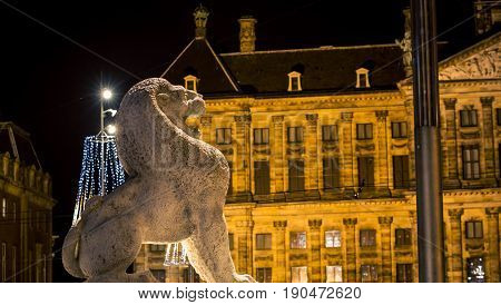 The lion at night in Dam Square Amsterdam