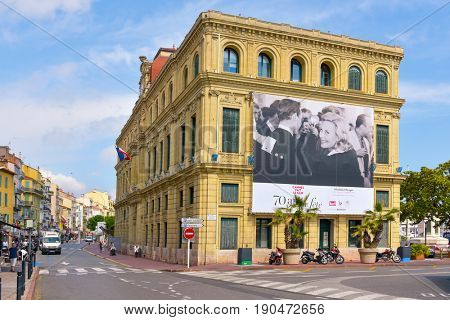 CANNES, FRANCE - JUNE 2, 2017: A lateral view of the Hotel de Ville, the City Hall, with a large signboard of the 70 edition of the Cannes Film Festival, celebrated just the week before