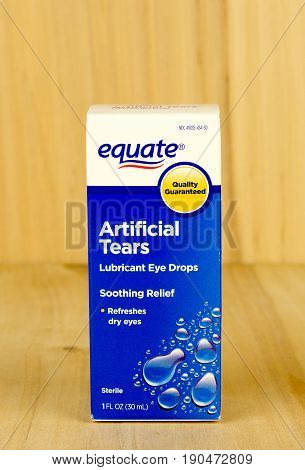 RIVER FALLS,WISCONSIN-JUNE 09,2017: A box of Equate brand artificial tears with a wood background.