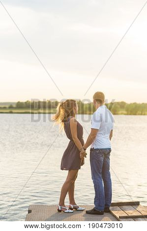 Romantic Couple on the pier in nature