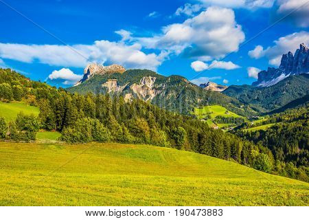 Warm autumn day. Rural pastoral in the Val de Funes, Dolomites. The slope of the mountain. The concept of ecological tourism