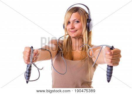 Blonde Woman Holding Skipping Rope Wearing Headphones