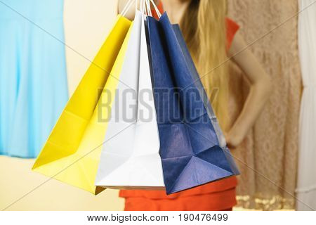 Unrecognizable Woman In Shop Picking Summer Outfit