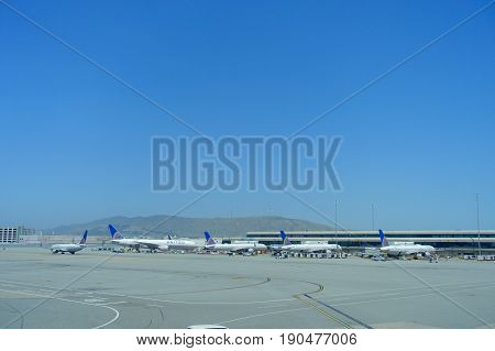 SAN FRANCISCO, CALIFORNIA - MAY 11, 2017: United Airlines planes at the Terminal in San Francisco International Airport in a sunny day.